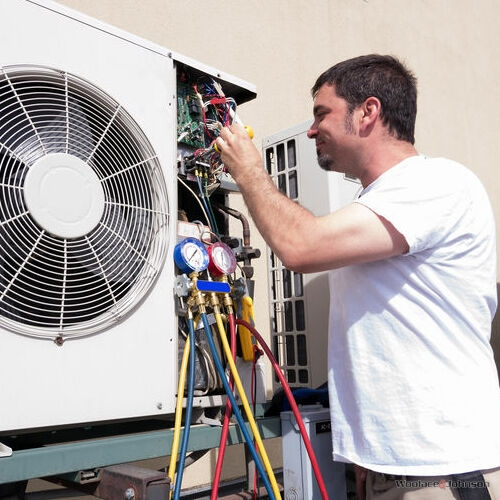 An HVAC Technician Makes Repairs.