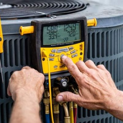 A Technician Tests an HVAC System.