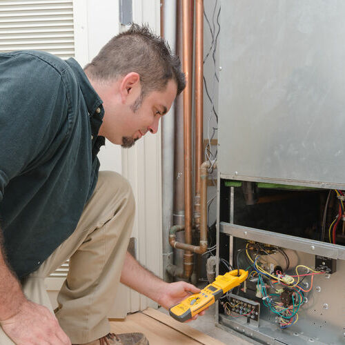 Technician Working on HVAC Service
