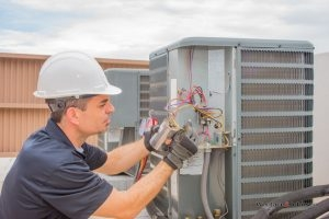 Air conditioner part replacements are complicated, but not a problem for the team of Woolace and Johnson.