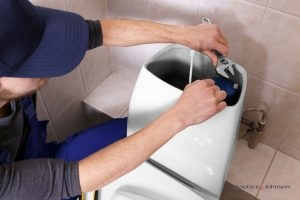 Plumber conducts toilet repair and installation services